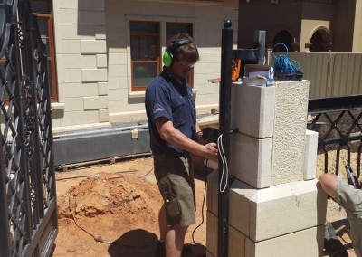 Installing a lock in a front gate pillar in Adelaide