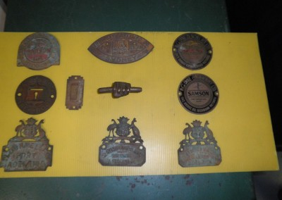 Historic emblems from second-hand safes restored by Clark Locksmiths
