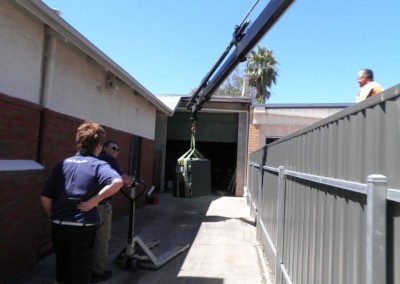 Using a crane to load a safe into one of Clarke Locksmiths vans for transportation at Clarke Locksmiths warehouse and showroom, The Parade, Norwood, South Australia S.A.5067