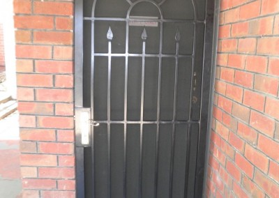 re-conditioned wrought iron security door installed