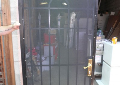 re-conditioned wrought iron security door painted black