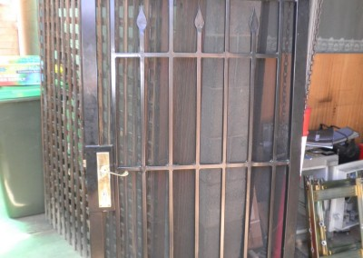 re-conditioned wrought iron security door powder coated