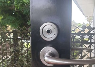 A door lock being changed in a regional South Australian residential property - After pic
